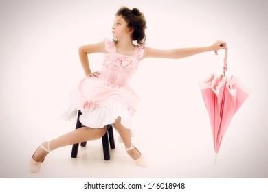 Beautiful Caucasian Girl Child in Pink Lolita Style Fashion with Polka Dot Umbrella
