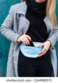 beautiful caucasian girl with a leather waist bag