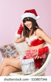 Beautiful caucasian girl  wearing Santa's hat and many christmas gift, isolated on white