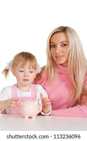 A beautiful Caucasian mama with her daughter with moneybox on a white background
