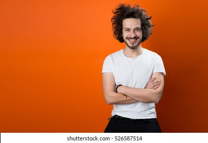 Beautiful caucasian man with funny hair over color background with copyspace