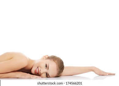 Beautiful caucasian naked woman lying down. Isolated on white.