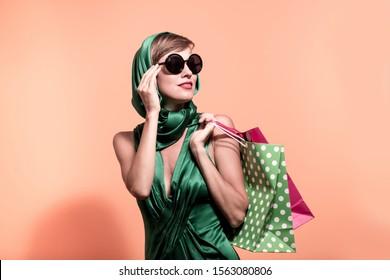 Beautiful caucasian shopping woman holding shopping bags