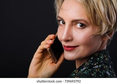 Beautiful caucasian short haired business woman close up portrait.