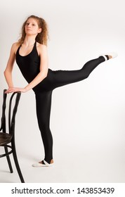 beautiful caucasian tall woman ballet dancer full length on studio white background