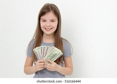 Beautiful caucasian teen girl with cash money USA