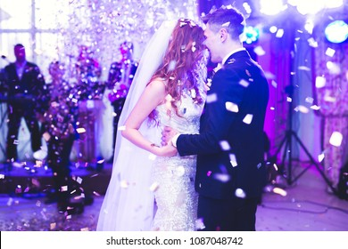 Beautiful caucasian wedding couple just married and dancing their first dance