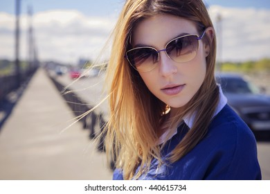 Beautiful caucasian woman in casual outfit outdoors walking, spending time in city. Sunny warm day. Stylish girl