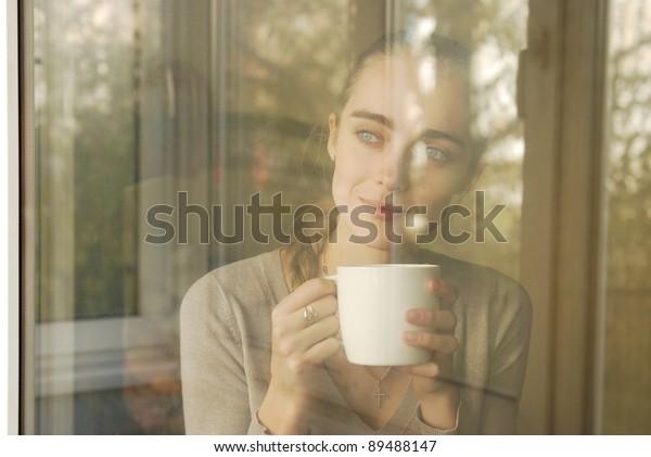 beautiful caucasian woman drinking coffee