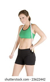 Beautiful Caucasian woman holding a jump rope in fitness clothes