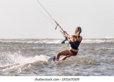 Beautiful Caucasian woman kitesurfing isolated on the sea, Sexy girl wearing bikini swim wear kiteboarding on the ocean 2021, Colombia kite-surfing girl