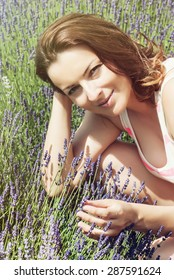 Beautiful caucasian woman in the lavender field. Beauty, fashion and nature.
