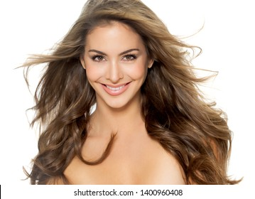 Beautiful Caucasian woman with long groomed hair posing on white background.