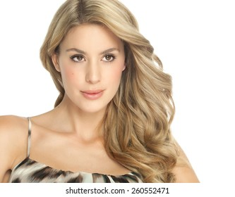 Beautiful Caucasian woman with long hair posing over white background.