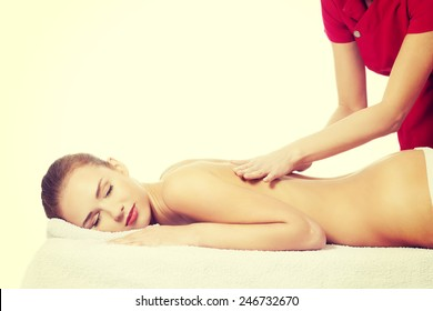 Beautiful caucasian woman lying on a massage table and relaxing.