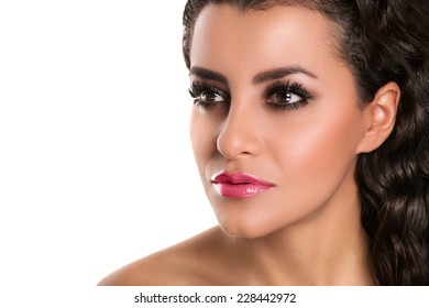 Beautiful caucasian woman with makeup, pink lips,  looking, isolated on white