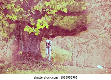 Beautiful caucasian woman posing under the massive maple tree. Sketch scene. Art technique. Natural beauty.