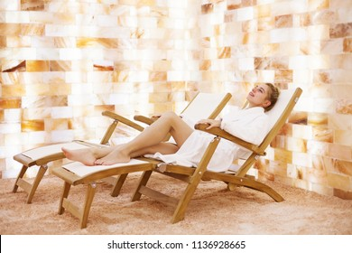 Beautiful caucasian woman in salt room in spa