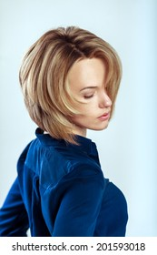 beautiful caucasian woman with short blond hair. glamour style photoshoot