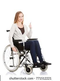 Beautiful caucasian woman sitting on a wheelchair.