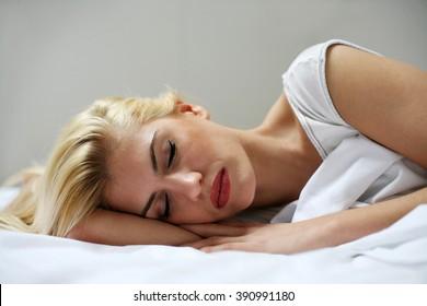Beautiful Caucasian woman sleeping in bed in the morning.