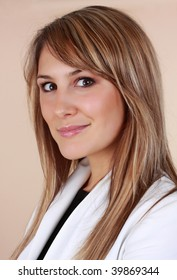 beautiful caucasian woman smiling, beige background