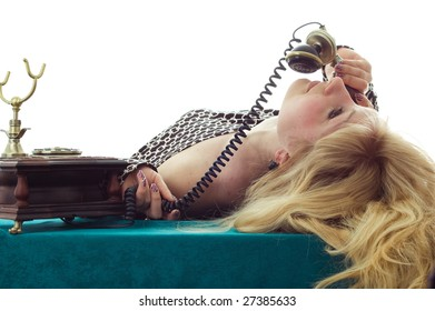 beautiful caucasian woman talking on retro phone.