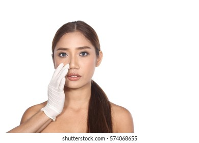 Beautiful Caucasian woman want to check eye, nose, eyebrow, forehead, cheek, jawline before plastic surgery, studio lighting white background copy space for text logo