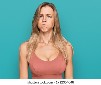 Beautiful caucasian woman wearing casual clothes puffing cheeks with funny face. mouth inflated with air, crazy expression.