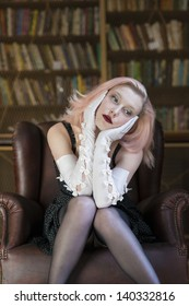 Beautiful caucasian woman wearing long white gloves lost in thoughts in old library