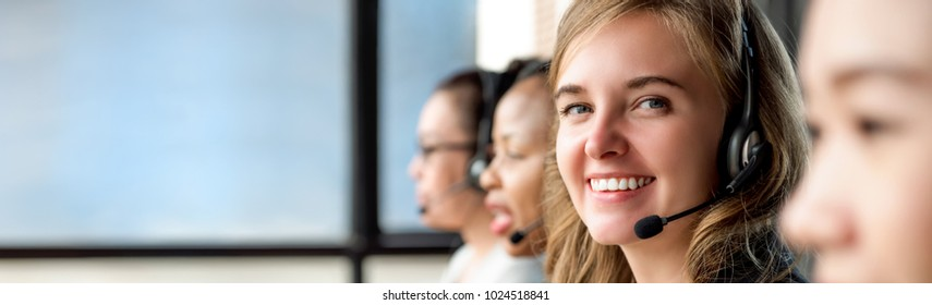 Beautiful caucasian woman wearing microphone headset working in call center with international team as telemarketing customer service agents, panoramic banner