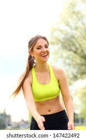 Beautiful caucasian woman working out in a park at sunny day
