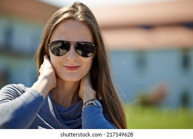 Beautiful caucasian young woman outdoor near her house, closeup with selective focus