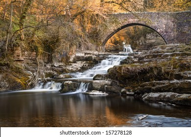 The beautiful Cauldron falls in the picturesque dales village of West Burton.  A late spring sunset lights up the surrounding foliage and upper falls.