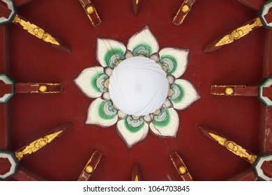 Beautiful ceiling in China. Chandelier in the form of a lotus flower on the ceiling