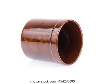 Beautiful ceramic brown cup isolated on white background
