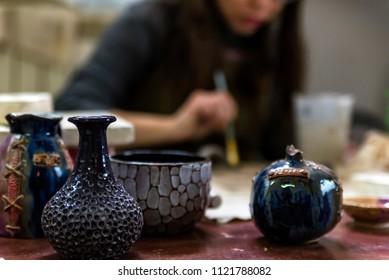 Beautiful ceramic vases at pottery workshop