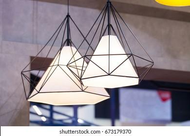 Beautiful chandelier. Modern chandelier hanging under ceiling