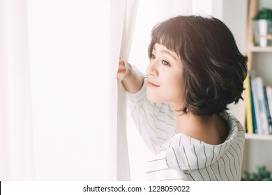 A beautiful charming asian girl positive young , girl has pleasant smile and good mood, happy expression