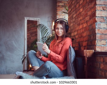 A beautiful charming brunette in a room with loft interior.