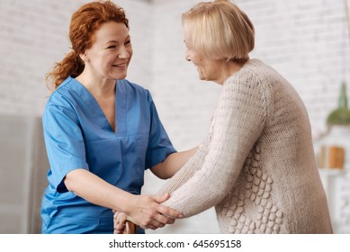 Beautiful charming doctor talking to her patient