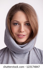 Beautiful charming girl in a wool gray sweater