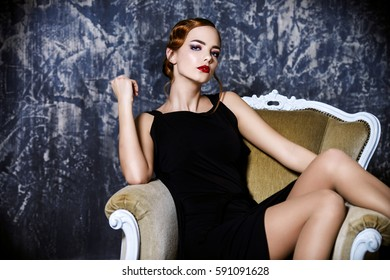 Beautiful charming woman with old fashioned make-up and finger wave hairstyle.  Luxurious life. Retro style of 20's and 30's. Beauty, fashion concept.