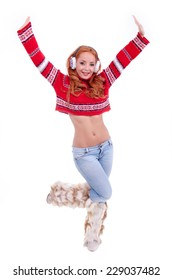 Beautiful charming woman with red hair with christmas sweater with white earmuffs