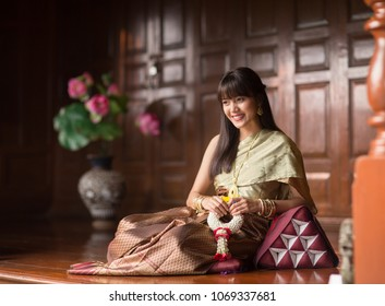 Beautiful and charming young Thai girl in flower garden, Ayutthaya, Thailand