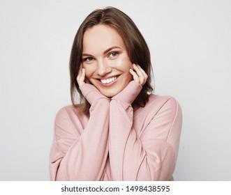 beautiful cheerful girl smiling laughing looking at camera