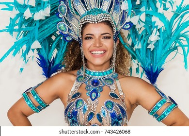Beautiful and cheerful samba dancer portrait wearing blue traditional costume