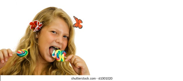 The beautiful and cheerful young girl the blonde with lollipops isolated on white background