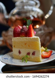 beautiful cheesecake with fresh fruits to offer teatime for peace on a garden background and select focus