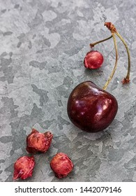 beautiful cherry on the table and on the saucer. Cherries and cherry stones, pits on a plate.